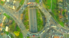 Aerial view of a truck and other traffic driving along a road at sunrise Stock Footage