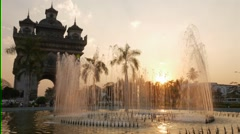 Timelapse of fountains at Patuxai at sunset,Vientiane,Laos Stock Footage