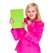 Smiling young business woman showing blank signboard - stock photo