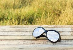 Clear sky in eyeglasses on the wooden background Stock Photos