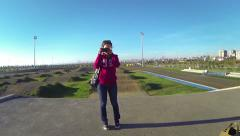 Young girl filming the drone with a mirrorless camera Stock Footage