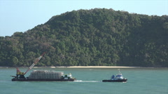 Tug boat pulling heavy cargo, Andaman Sea, Phuket Harbour, Thailand Stock Footage