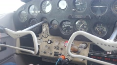 Pilot adjust knobs during flight - stock footage