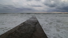Waves of the Black sea during a storm crashing against the breakwater. Sochi - stock footage