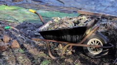 Pull Focus Wheel Barrow Rural Allotment Gardening Tools Village - Morning Light Stock Footage