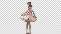 Little pretty girl in dress with tails spins, whirls, dances. Front view. Stock Footage