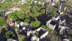 Aerial view of the ghost town of Kayakoy. A reminder of the fragility of harmony Stock Footage