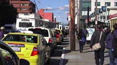 San Francisco, taxi cabs and crowd walking Stock Footage