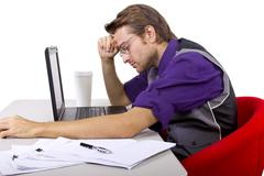 Stock Photo of Tax Season / Tired Worker