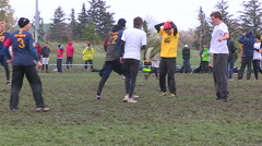 Cold wet rain high wind at college university ultimate frisbee sports event - stock footage