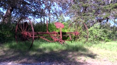 Old rusty farm equipment maybe pulled by horses Stock Footage