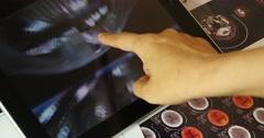 4k doctor study Mri Scanner on ipad,head & organ pet-ct. Stock Footage