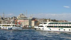 Passenger ships and Suleymaniye Mosque at Eminonu in Istanbul Stock Footage