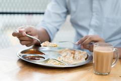 Man having Indian meal Kuvituskuvat