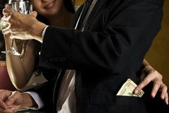 Con-Artist Stealing Money - stock photo