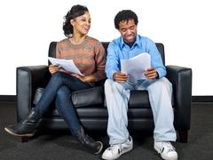Two Actors on a Couch Waiting for Audition Stock Photos