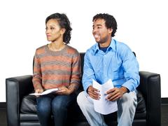 Two Actors on a Couch Waiting for Audition - stock photo