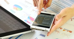 4k Businessman search information on ipad,study financial data on smartPhone. - stock footage