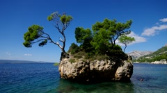 Brela in Croatia, the beach and a diver Stock Footage