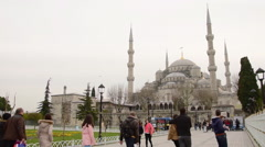 Blue Mosque, Sultanahmet, Istanbul, tourists are walking on yard Stock Footage