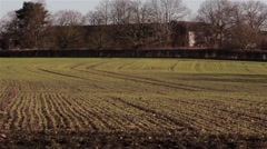 Interesting Patterns on Farmed Plowed Field Lines Stretch Away - Cultivated Soil Stock Footage