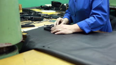 View of worker carves leather details for shoes Stock Footage
