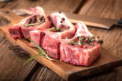 Raw lamb chop ready for frying. - stock photo