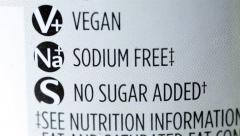 Close Up Food Packaging Label for Vegan, Sodium Free and No Sugar Added Stock Footage