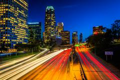 Traffic on the 110 Freeway and the Los Angeles Skyline at night, seen from th - stock photo