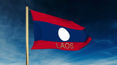 Laos flag slider style with title. Waving in the wind with cloud background Stock Footage
