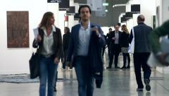 People visit the stands of an Art fair in Milan, Italy Stock Footage