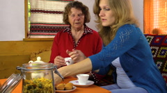 Tea time cupcake in village room, woman give grandmother sugar Stock Footage
