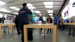 People playing new iphone inside Apple store, shot with fisheye len. Stock Footage