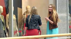 Two blondes on shopping discuss something very emotional about windows Stock Footage