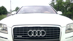 Outstanding Front view of Audi A8 L moving in the city Stock Footage