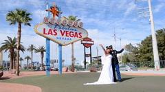 wedding ceremony near Las Vegas sign on the Las Vegas Strip, Las Vegas, Nevada. - stock footage