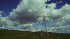 Electricity,high voltage pylons,power transmission lines in the countryside - stock footage