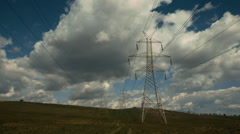 Electricity,high voltage pylons,power transmission lines in the countryside Stock Footage