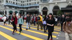 People on a pedestrian crossing in the central district of Hong Kong - stock footage