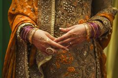 Indian bride with jewelry and henna Stock Photos