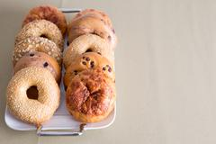 Tray of Bagels Placed on a Table with Copy Space - stock photo