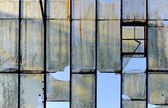 Old broken glass roof - stock photo