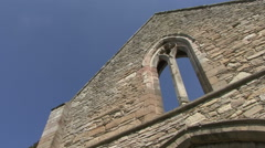 Pan across end wall of medieval building. Stock Footage