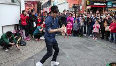 Boys playing with a toy yo-yo on the waterfront of Hong Kong Stock Footage