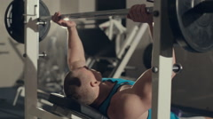 Bodybuilder in the exercise machine  build muscles with a barbell Stock Footage