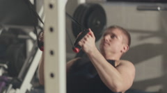 Sportsman doing chin-up in gym Stock Footage