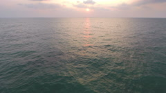 Flying over endless sea at sunset Stock Footage
