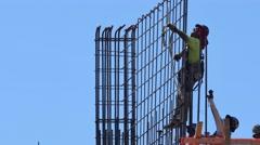 Men at work on rebar - stock footage