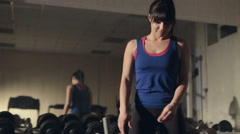 Beautiful young woman doing abdominal exercises on Roman chair in the gym in Stock Footage