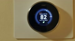 Nest wifi thermostat in action Stock Footage
